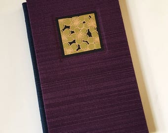 Purple Hard-Cover Pamphlet-Sewn Journal with Green Flowers
