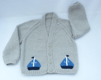 Knitted baby clothes. Baby sweater. Hand knitted  grey  baby cardigan to fit a 6 to 12 months baby. Baby clothes, baby gift, baby shower.