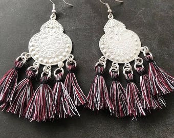 Lightweight dangle earrings with silver and several pendant tassels