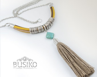Fringe tassel necklace boho. Simple multi tassel jewelry hippie style. Leather cord pendant with brown tassels, turquoise and silver rings.