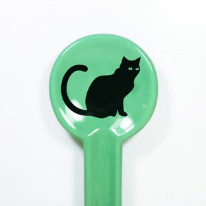 A Spoon Rest Glazed In Blue Green With A Black Cat Print, Made To Order