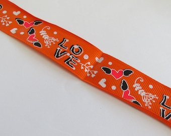 Pretty orange Ribbon with love and heart pattern