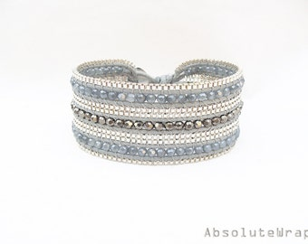 Silver gray crystal single wrap bracelet with silver plated chain trimming on soft polyester cord