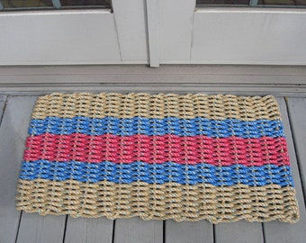 Tan, Nantucket red and blue handwoven doormat from lobster trap rope.