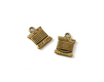 Set of 2 charms coils antique brass 15 x 11 mm