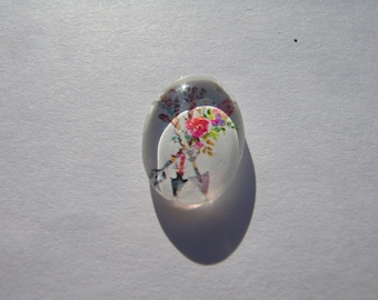 Oval glass cabochon 13 X 18 mm with the image of arrows and feathers