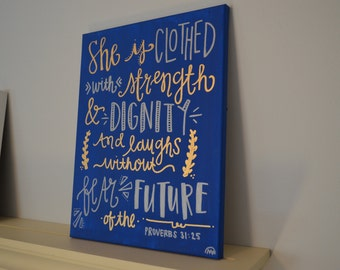 She is Clothed with Strength and Dignity Quote Board