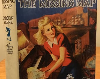 The Quest of the Missing Map - A Nancy Drew Mystery by Carolyn Keene. Early printing in Nice Dust Jacket