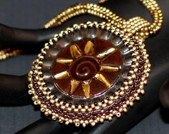 Golden Aztec Sun ... Necklace . Beadwoven . Stoneware Cabochon . Metallic . Bronze . Gold . Ndebele Rope . Radiant . Elegant