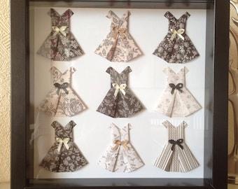 Mini origami dresses in box frame.