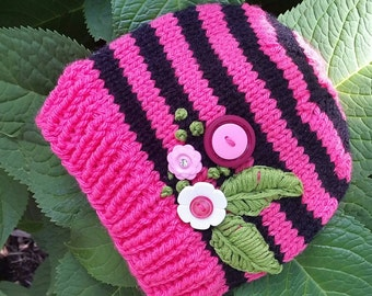 Pink and black hat with buttons and embroidery