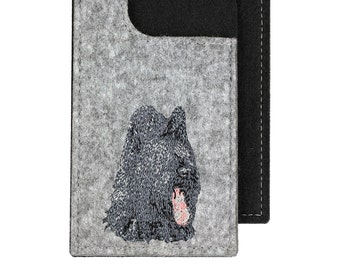 Briard - A felt phone case with an embroidered image of a dog.