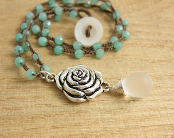 Crocheted Necklace with a Brown Cord, Faceted Aqua Jade Beads, a Pewter Rose Pendant and a Frosted Glass Teardrop SN-398