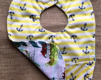 Nautical anchors and lighthouses waterproof baby bib with pocket and snap