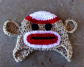 Sock Monkey inspired hats in three colors with earflaps, tassles & accent ears for warmth and fun!