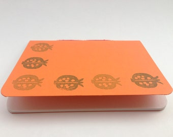 Orange notebook, handmade, stitched spine, handprinted, pomegranate