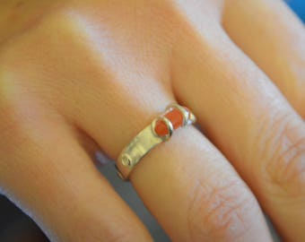 A Beautiful Sterling Silver ladies ring with an Orange Carnelian Stone.