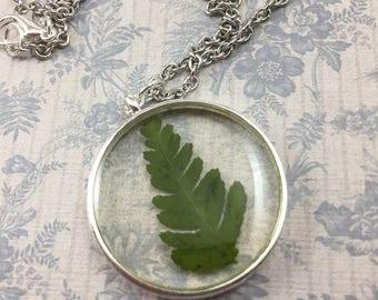Fern necklace in silver circle bezel