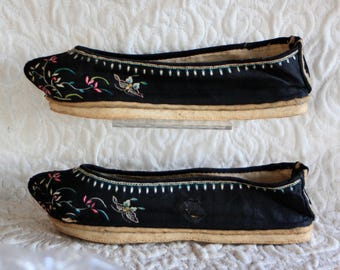 Pair of Antique Chinese Manchu Womans handmade embroidered shoes