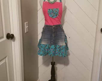 Repurposed denim jeans, this unique, one of a kind apron is the perfect gift for any occasion. Has turtles on ruffle.