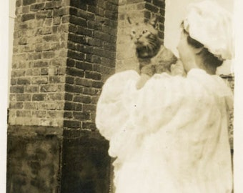 snapshot 1915 Woman Holds Cat Over her Back Shoulder on Roof Brick Chimney