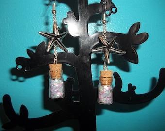 vial and star earrings sea
