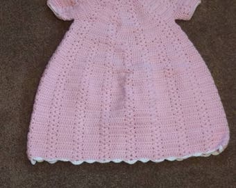 Baby girl hand crochet pink dress with white trim