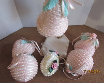 six vintage hand made ornaments Pink and one white