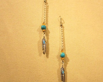 Silver tone turquoise feather earrings with semi precious stone that you choose.
