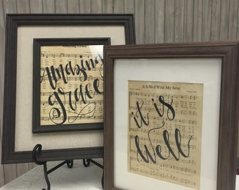 Aged hymn with hand written modern calligraphy phrases or song title