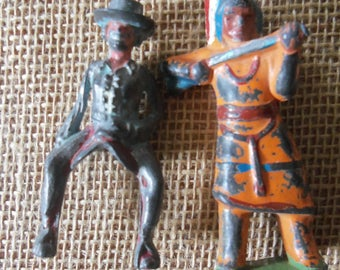 Two Vintage Cast Iron Figures Indian chief and Cowgirl