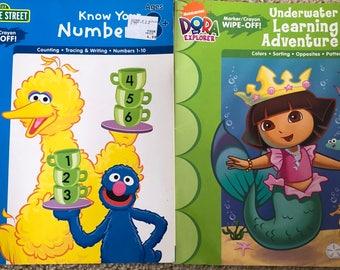 2 Children's Educational Books, Marker Crayon Wipe Off, Sesame Street and Dora The Explorer, Learning Horizons Books