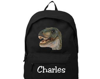 bag has black back dinosaur personalized with name