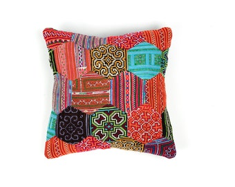 Decorative pillowcase with beehive pattern made of pieces from different vintage Hmong skirts