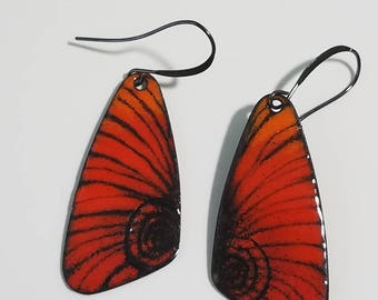 Bright orange and black torch fired copper enameled earrings.