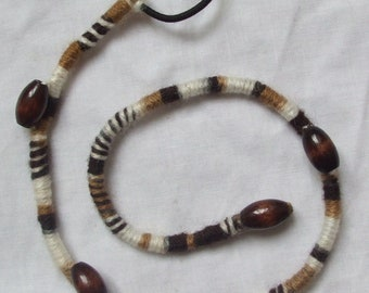 Johnson Brown and white, camouflage, decorated with painted wooden beads