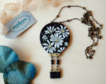 Wooden necklace with hot air balloon. Flowered Meadow with Daisies