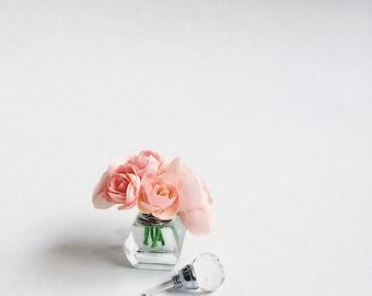 "2.5"" pink ranunculus in mini perfume bottle vase"