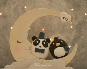 Panda and penguin wedding cake topper