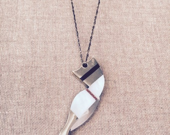 Chic mini white mother of pearl sexy leg pocket knife necklace. Red garter