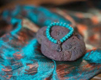 turquoise stone bracelet with spiral design