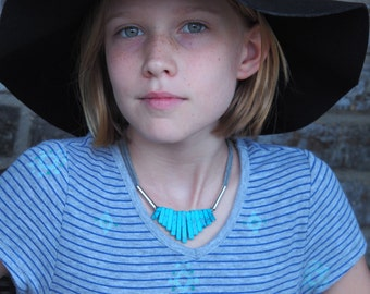Turquoise graduated necklace with silver and grey cotton jersey