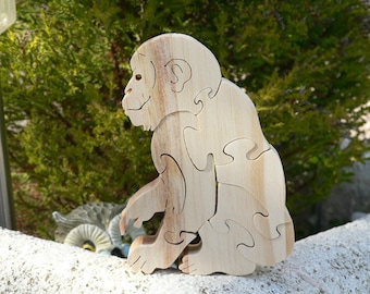 """Chimp"" wooden puzzle toy in woodcut"