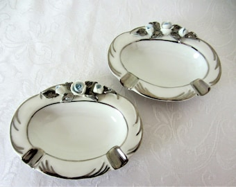 Dresden Porcelain Boudoir Size Ashtrays With Blue Tint White Roses And Silver Trim. Set Of Two