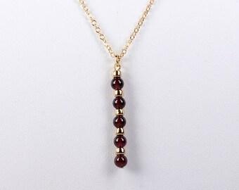 Garnet and Gold Bloodline Pendant Necklace