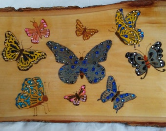 Butterflies wood burned and painted sign wall decor with gray, blue, yellow and pink butterflies embellished with colored crystals