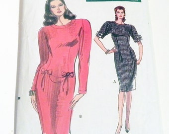 """1980s Fitted dress Short long sleeves Bows Pleats shoulder pads tapered sewing pattern Vogue 7602  Size 14 Bust 36"""""""