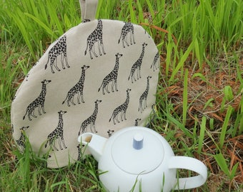 A tea cosy with a giraffe design.  Size large,  made to fit a 4 - 5 cup teapot.