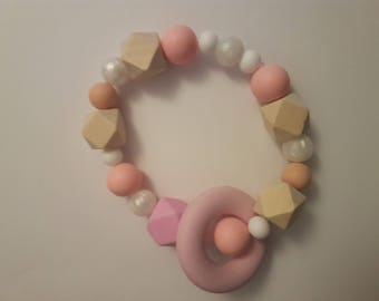 Pink and white teething ring