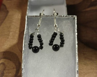 Hoop earrings with tiny black beads